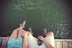Couple on a dock. Summertime photo of a couple holding hands on a dock Stock Photography