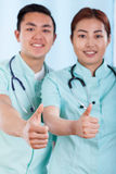 Couple of doctors with okay gesture Stock Image