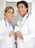 Couple of doctors with tablets Royalty Free Stock Photos