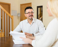 Couple with documents at home Royalty Free Stock Image