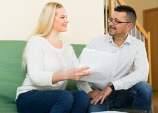 Couple with documents at home Stock Image