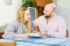 Couple with documents indoor Stock Photography