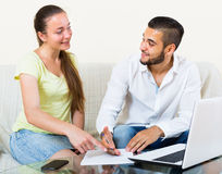 Couple with documents and notebook Royalty Free Stock Photos