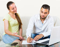 Couple with documents and notebook Royalty Free Stock Photography