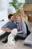 Couple with dog. At their new home Royalty Free Stock Images