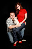 Couple with dog. Portrait of a young couple with their dog Royalty Free Stock Photos