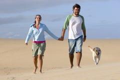 Couple with a dog stock photos