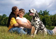Couple with a dog Stock Photography