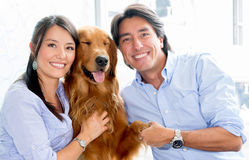 Couple with a dog Royalty Free Stock Photos