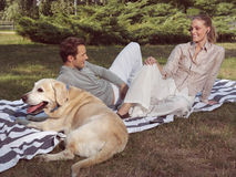Couple with dog Royalty Free Stock Photo