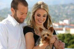 Couple and dog Stock Photos