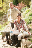 Couple With Dog Having Coffee Break Stock Photography