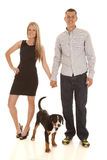 Couple with dog holding hands Royalty Free Stock Photos