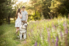 Couple with a dog Royalty Free Stock Image