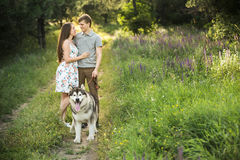 Couple with a dog Stock Photos