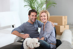 Couple and dog move into home. Couple and dog move in to new home Royalty Free Stock Images