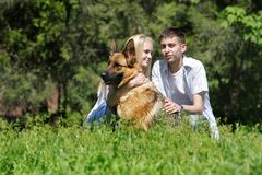Couple with dog outdoors Stock Photography
