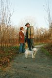 Couple and dog on path Stock Photos