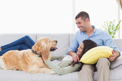 Couple with dog on sofa Royalty Free Stock Image