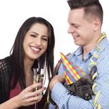 Couple with dog and sparkling wine glasses Stock Images