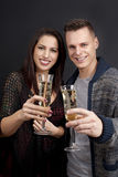 Couple with dog and sparkling wine glasses Royalty Free Stock Images