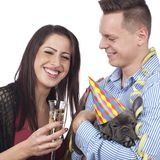 Couple with dog and sparkling wine glasses Stock Photo