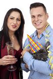 Couple with dog and sparkling wine Royalty Free Stock Photos