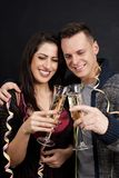 Couple with dog and sparkling wine glasses Royalty Free Stock Image