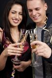 Couple with dog and sparkling wine glasses Royalty Free Stock Photo