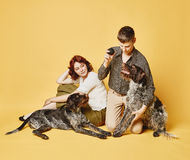 Couple and dog together, 70's look theme Stock Photos