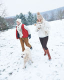 Couple with dog on a walk in winter Stock Photo