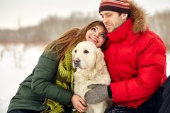 Couple with a dog on winter Royalty Free Stock Image