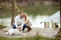 Couple with dog Stock Image