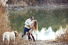 Couple with dog Royalty Free Stock Photos