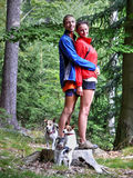 Couple with dogs in forest Royalty Free Stock Photo