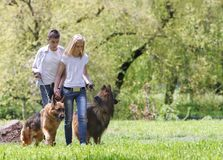 Couple with dogs outdoors Royalty Free Stock Photos