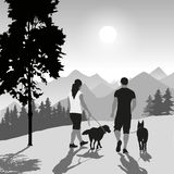 Couple with dogs Royalty Free Stock Images