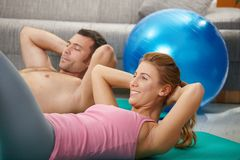 Couple doing abdominal crunch Royalty Free Stock Photo