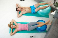 Couple doing abdominal crunch Stock Image