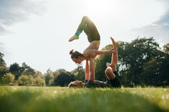 Couple doing acro yoga in park Royalty Free Stock Photography