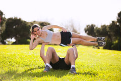 Couple doing acrobatic exercises Royalty Free Stock Images