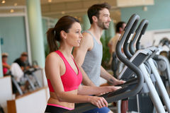 Couple doing cardio training in a fitness center Stock Images