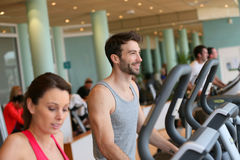 Couple doing cardio training in fitness club Stock Photos