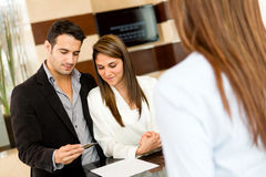 Couple doing check-in at a hotel Stock Photos