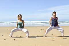Couple doing chi kung. On the beach Royalty Free Stock Photography