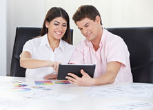 Couple doing color consultation Stock Photography