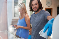 Couple doing the dishes stock images