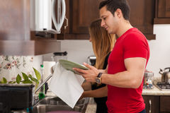 Couple doing the dishes Stock Photo