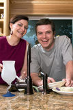 Couple Doing Dishes - Vertical Royalty Free Stock Photo