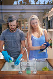 Couple doing the dishes Stock Photos